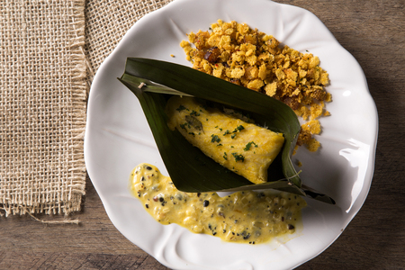 Fried fish with farofa and passion fruit sauce - Traditional amazonian dish - Filhote caboclo Stock Photo