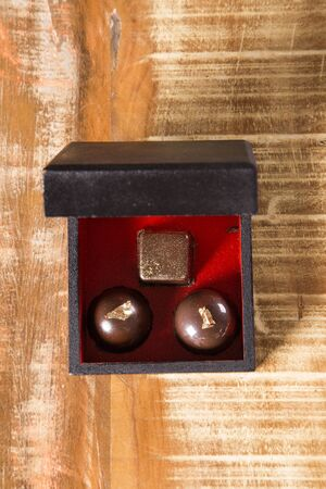 Chocolate bonbon with golden leaves