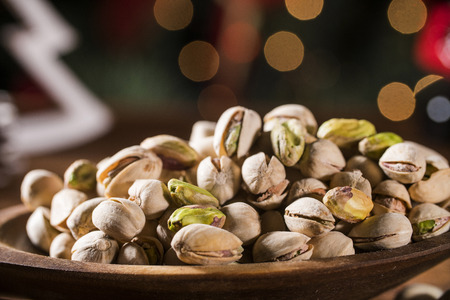 Closeup of some roasted pistachio on rustic old wooden table Stock Photo