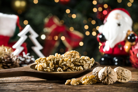 Walnut kernels on rustic old wooden table