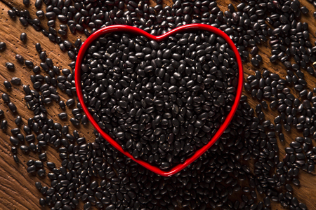black beans on wood background