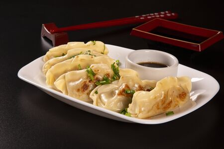 Gyoza or pasta with stuffing of beef, beef or pork or vegetables. Asian cuisine dish