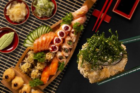 Japanese food combo in black background.