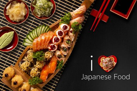 Japanese food combo in black background.itten I love japanese food in english. Top view.