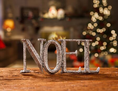 Merry Christmas greeting message on wooden background. Santa Claus written in Portuguese. Noel Standard-Bild