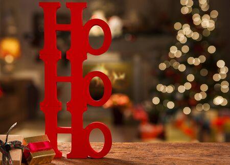 Merry Christmas ho ho ho greeting message with christmas blurry light background.