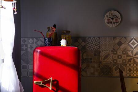 kitchen with old decking and red refrigerator. Retro ambient kitchen Standard-Bild