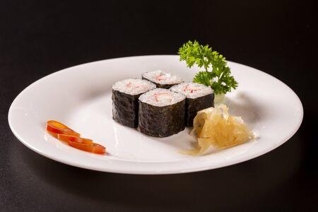 Sushi plate on black background.