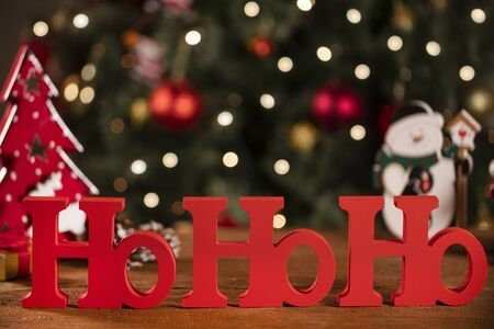 Merry Christmas ho ho ho greeting message with christmas blurry light background Standard-Bild