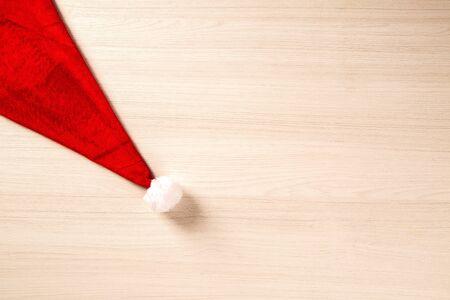 Santa's hat on wooden planks. Christmas background