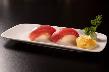 Tuna Nigiri, Sushi Tuna, Japanese food on ceramic dish, Japanese food style, Japanese menu, sushi tuna, maguro sushi on dish background, selective focus
