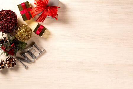 Christmas decorations and ornament on wooden background. View from above.