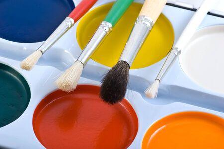 Paint brushes  and paint pallet closeup