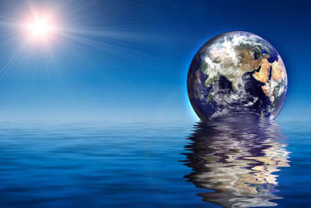 Earth like planet rise over ocean Stock Photo - 1932652