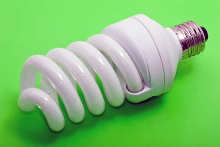 electrical fluorescent energy-saving lamp at green Imagens