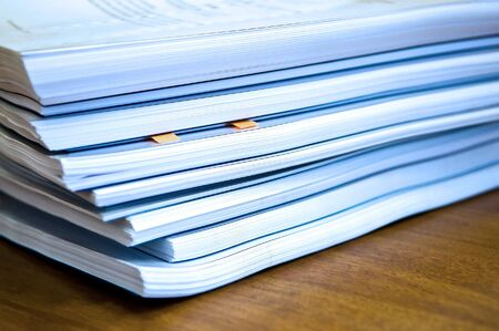 Piles of documents lying on a table