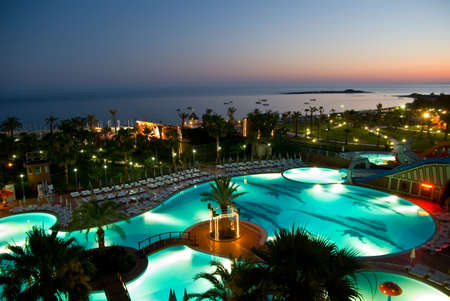 luxury hotel with pool at night Editorial