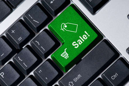 Personal computer keyboard with green key Sale Stock Photo - 3666870
