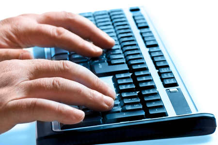Keyboard with hands closeup view photo
