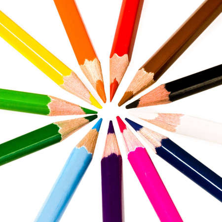 Wooden color pencils over white photo