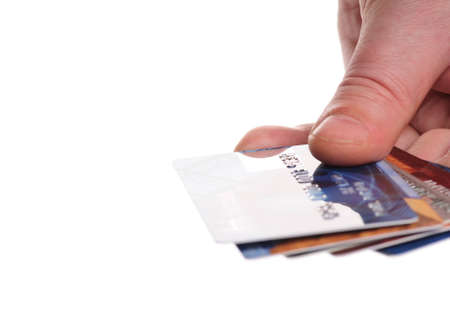 Hand holding credit cards. Small DOF. Isolated Stock Photo - 4043680