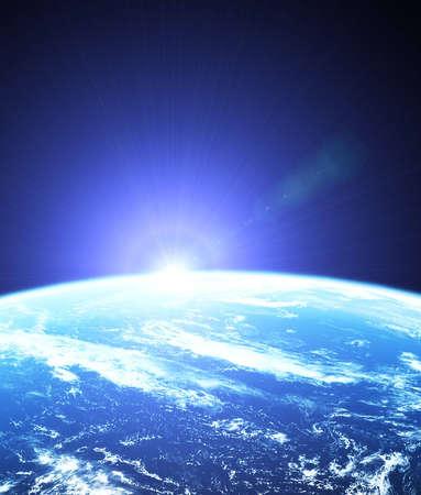 日の出と宇宙から見た地球 写真素材
