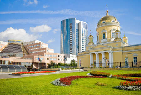 View of Yekaterinburg city. Cathedral of a sacred Trinity, business center and hotel Imagens