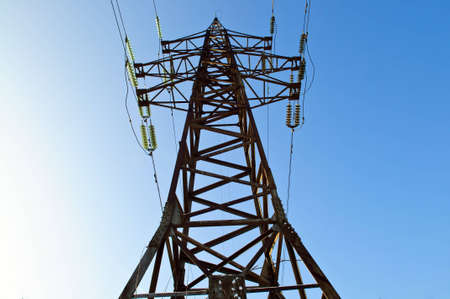over voltage: power energy high voltage tower over blue sky