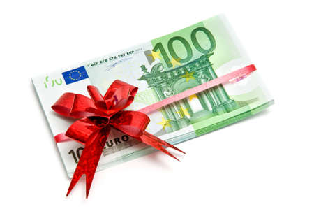 Banknotes tied red ribbon isolated on white Stock Photo