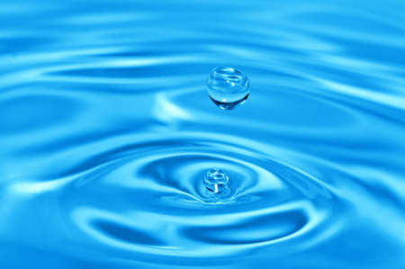 waterdrop over water splashing background  photo