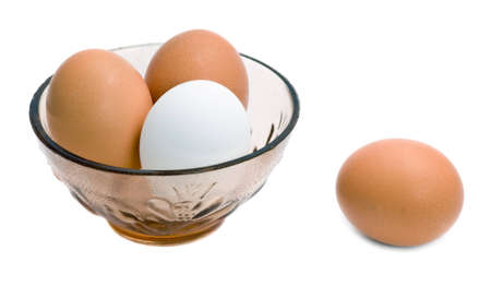 Eggs in glass bowl isolated on the white background photo