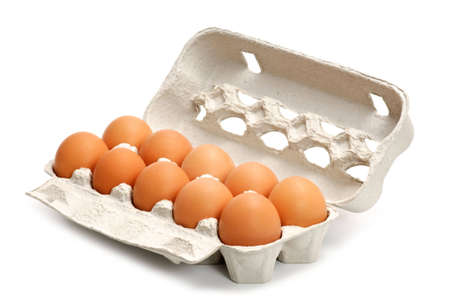 Eggs in a box isolated on white Stock Photo - 4698250