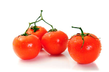 Group tomato isolated over white. Focus on first photo