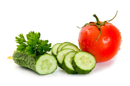 Red tomato, green cucumber and parsley on a white background photo