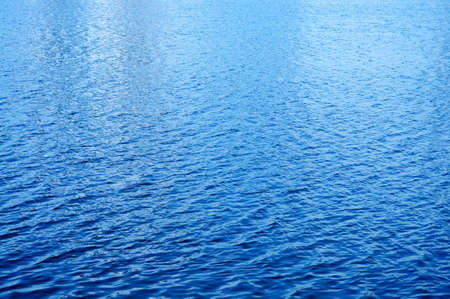 Day light reflected on the water surface photo