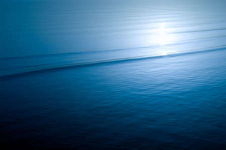 peaceful sea water surface with sunlight reflection Stock Photo