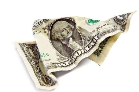 Een gerimpelde dollar geïsoleerd op wit Stockfoto