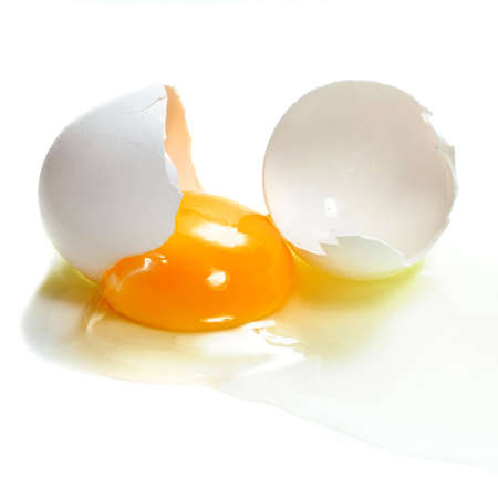 A cracked egg isolated  Stock Photo