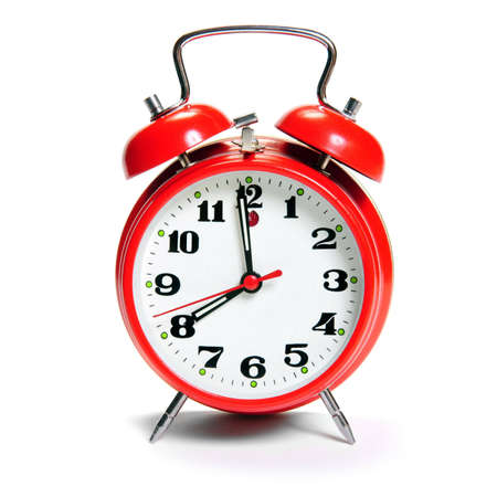 old fashion Alarm clock isolated on white photo