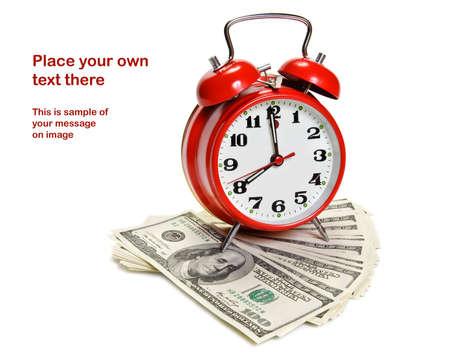 Alarm clock over pile of money Standard-Bild