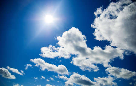 sunny sky with clouds and beams Stock Photo