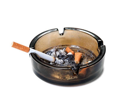 quiting: ashtray and cigarettes on white background