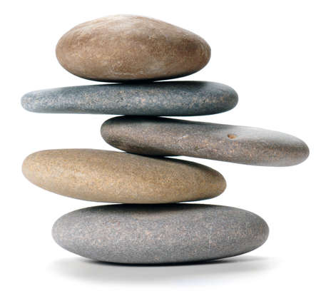 An isolated balanced stone tower on white background