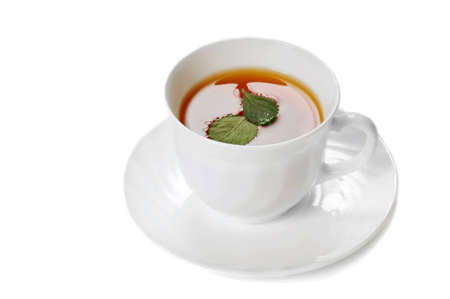 robustness: herbal tea in cup isolated over white