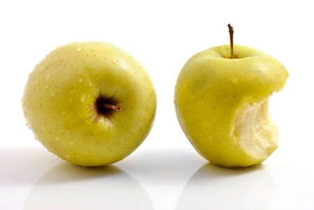 nibble: Two apples: whole and with piece bitten
