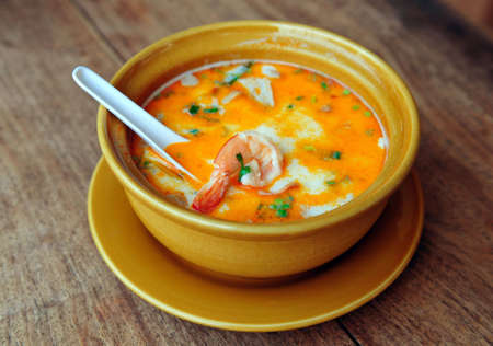 yum: Bowl of spicy Thai Tom Yum Soup Stock Photo