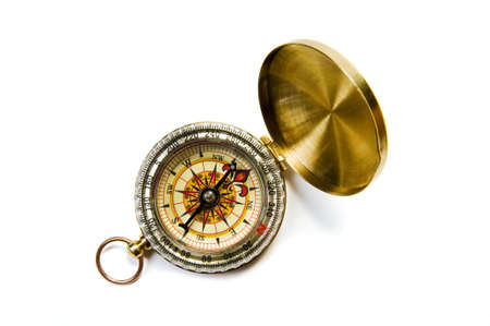 Antique brass compass on white background with soft shadow  photo