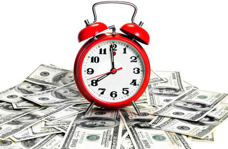 Time is money concept - classic alarm clock over dollars. High contranst  photo