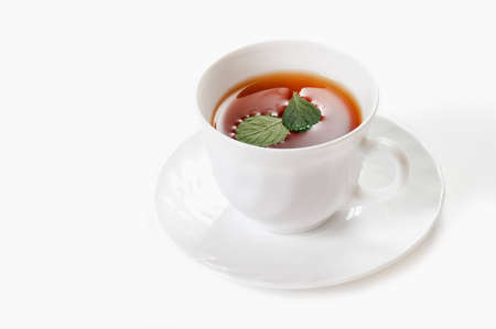 Cup of tea with mint over white (not isolated) Stock Photo - 7033930