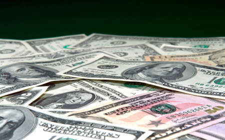 Dollar background over dark green with copyspace Stock Photo - 7451047